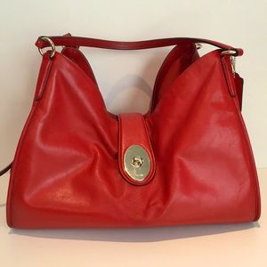 Coach red leather bag with 3 interior areas.